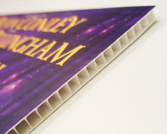 Side view of a stack of printed Correx signs